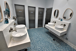 Sparkly clean, modern bathrooms are available on each floor of Gaslamp Hostel.