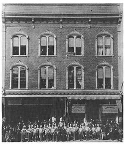 A historic picture of the now Gaslamp Hostel shows children in the windows and a group out front.