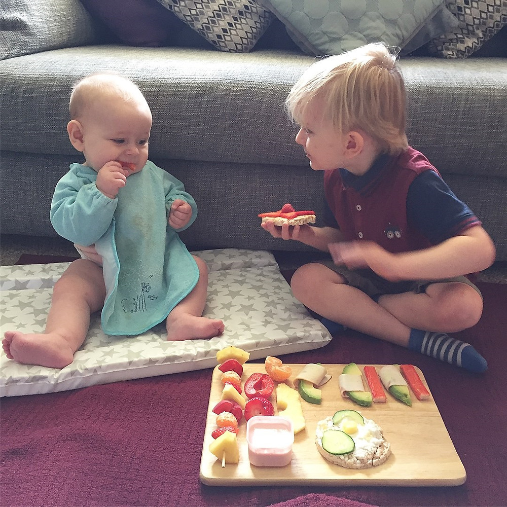 Boys enjoying a floor picnic. Baby-led weaning