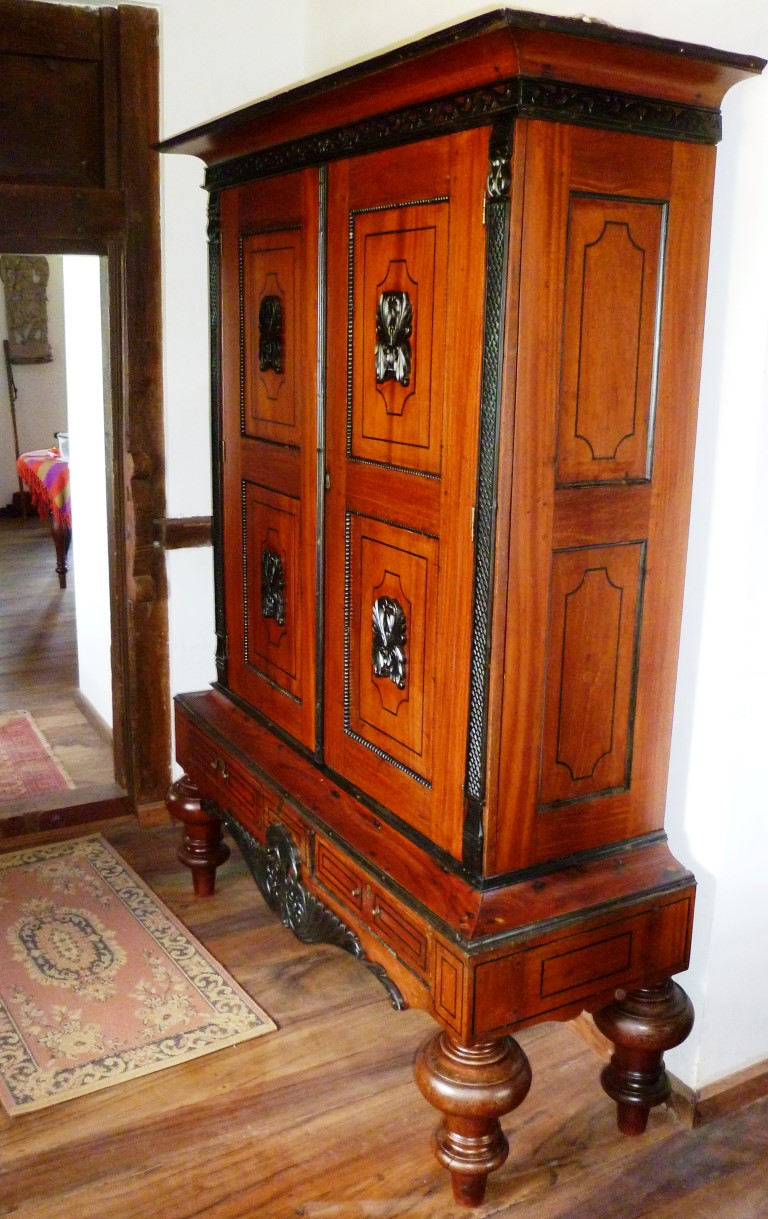 Antique cupboard with ebony carvings