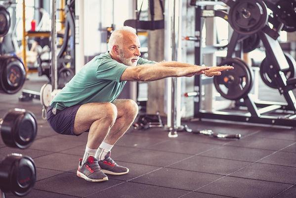 senior-man-doing-squats.jpg