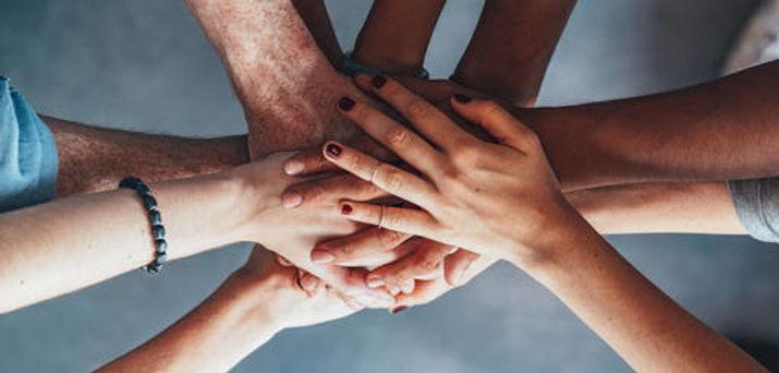 4 support-group-hands-together.jpg