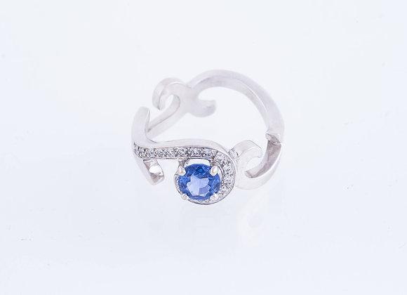 Bague arabesque saphir bleu et diamants