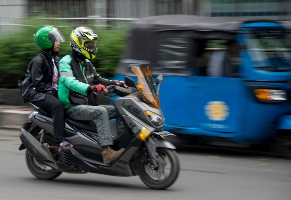 A Grab motorcycle-taxi transporting a passenger in Jakarta, Indonesia. BAY ISMOYO/AFP VIA GETTY IMAGES