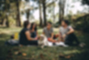 group-of-people-sitting-on-white-mat-on-