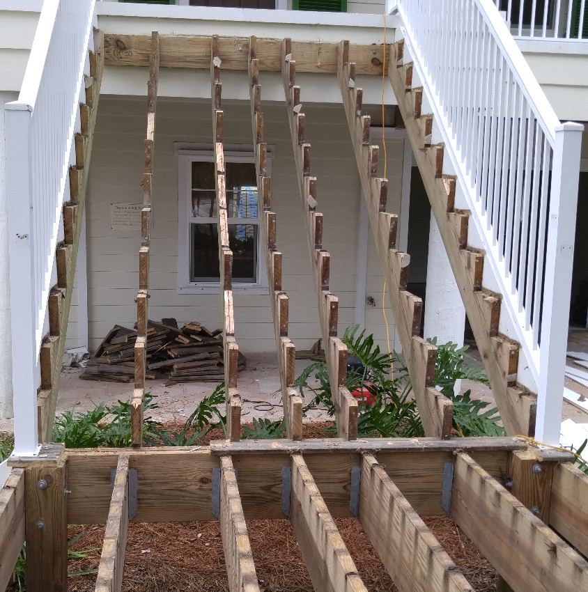 Old stair tread, risers and hand rails removed.
