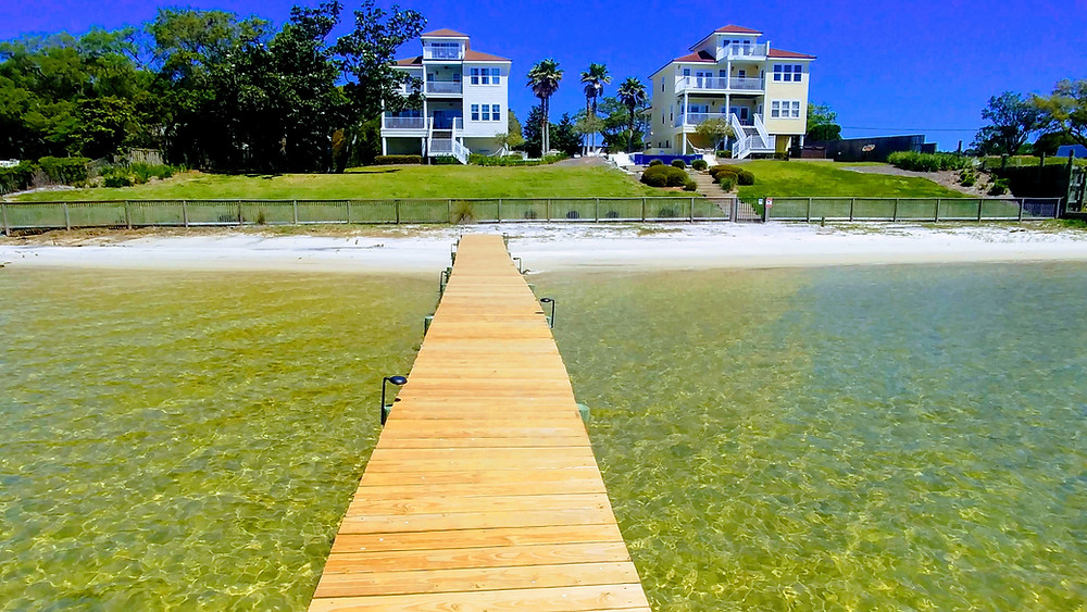 View of Seahorse Retreat and Palm Breeze Beach House from the dock on the Santa Rosa Sound