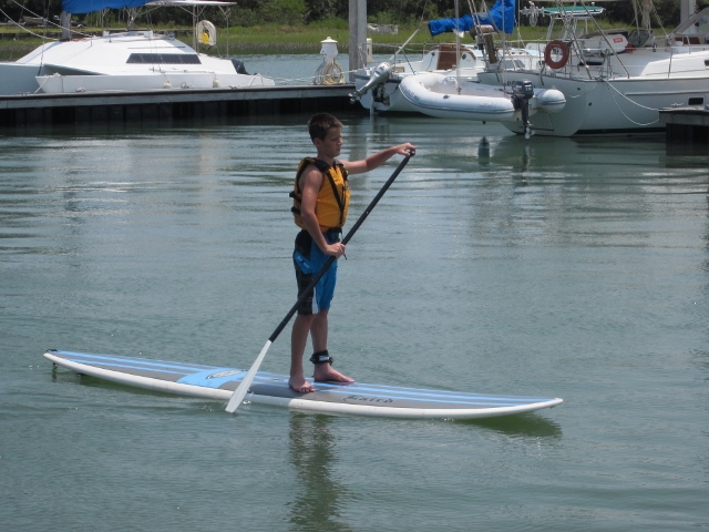 Our son, Christopher, paddle boarding on the Folly River.