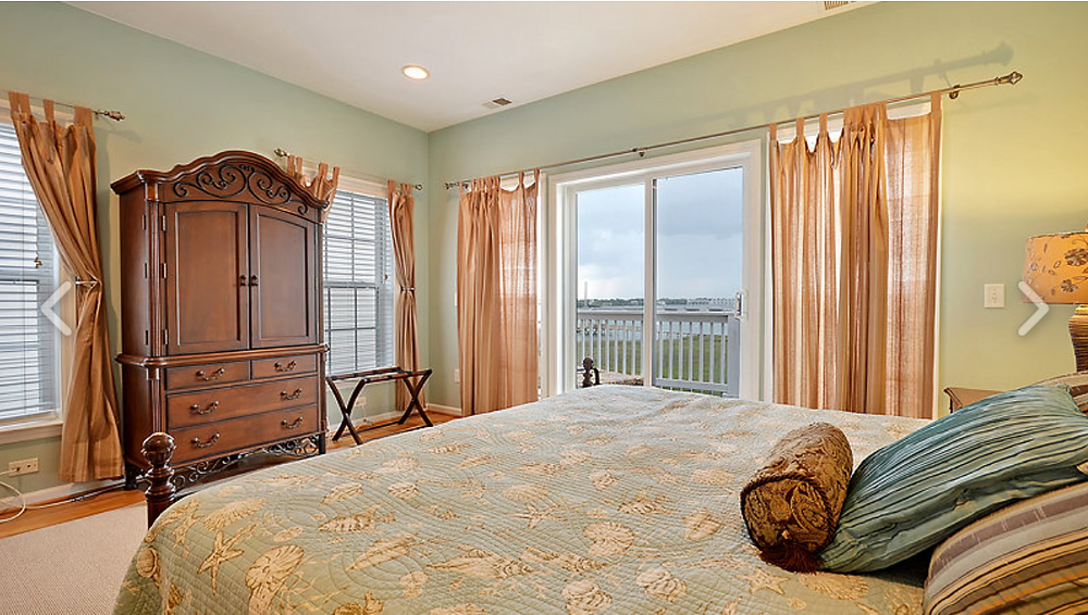 106 Water's Edge townhome master bedroom photo overlooking the Folly River.
