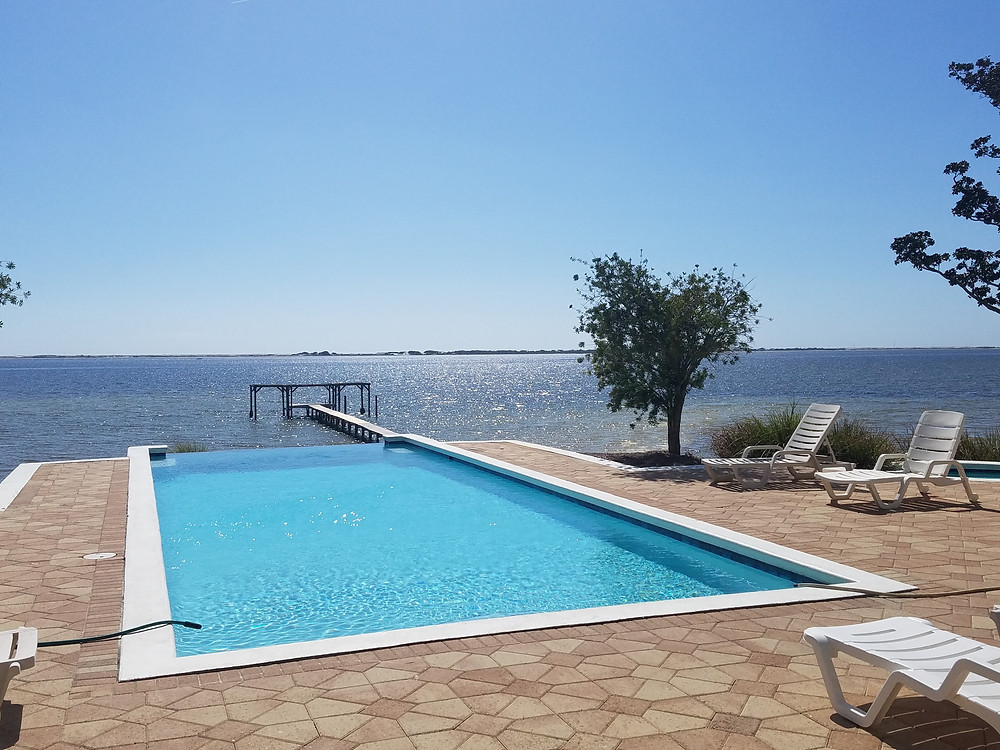 Infinity-edge pool with view to the Santa Rosa Sound