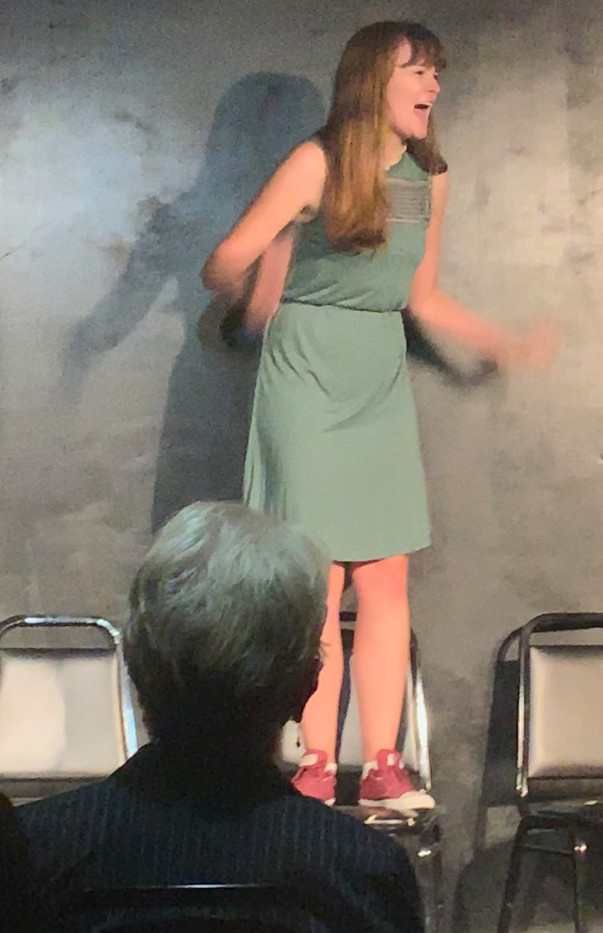 Elise improvising in Volcano: The Musical at The Magnet Training Center.