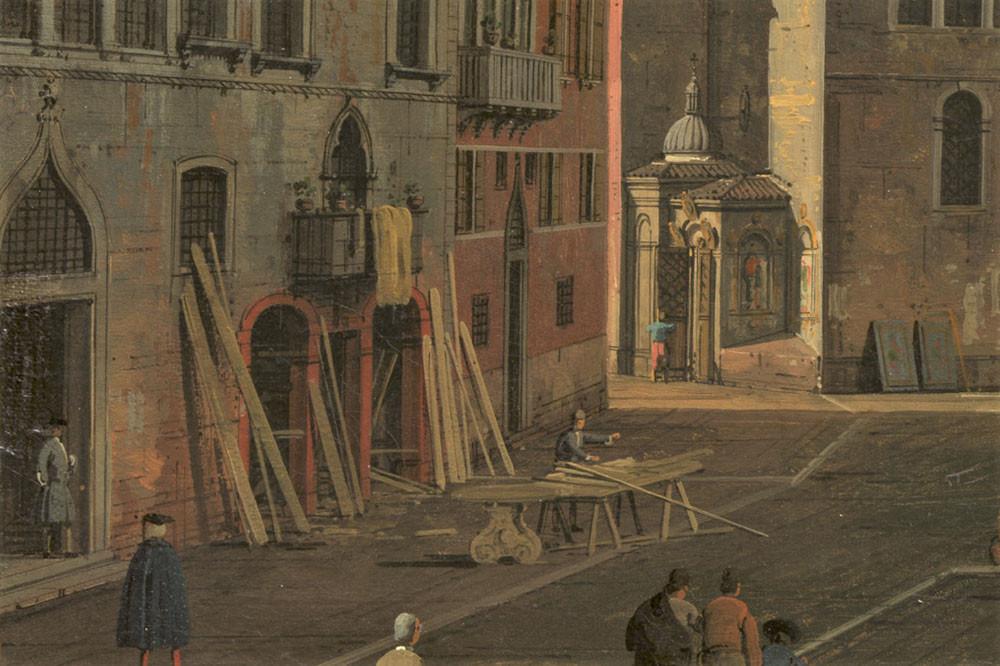 Varias tiendas de carpinteros o ebanistas, incluida una que destaca a la izquierda con tablas de madera y un banco de trabajo