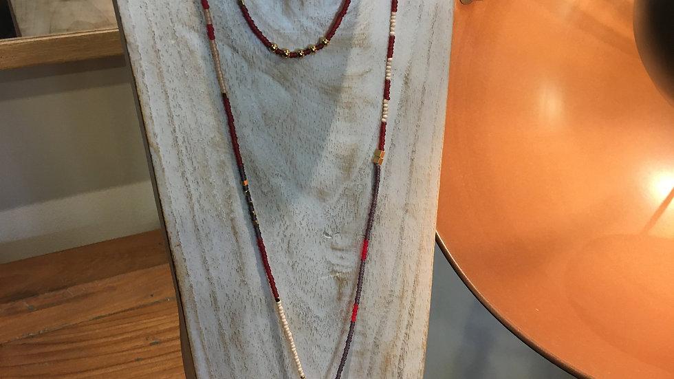 Sautoir doré avec perles dégradé de rouge