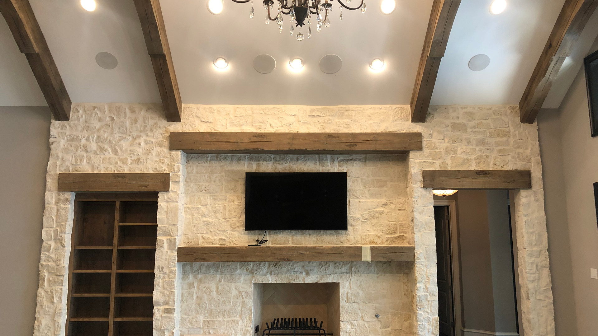 Fireplace and built-ins are accented by heavy timer beamwork