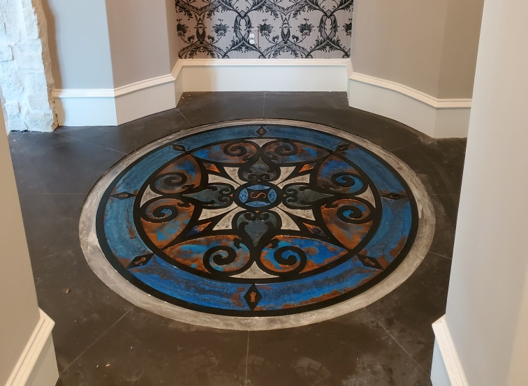 Custom floor design in round transition space at the media room