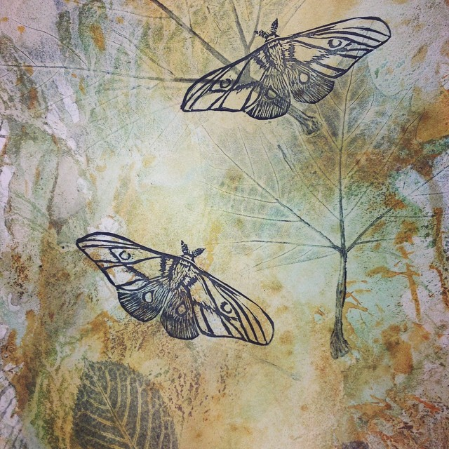 Moths on rusted paper