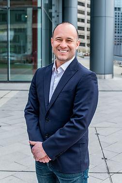 Tomlinson, Corban-partner Mario Levine-3