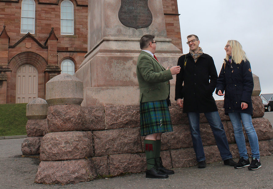 Dan with happy guests on a walking tour of Inverness by Airts & Pairts - Elle Tyler
