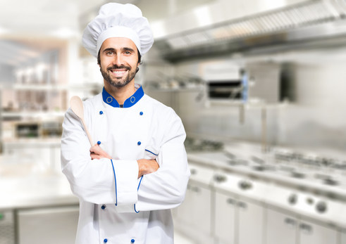 Smiling chef in his kitchen.jpg
