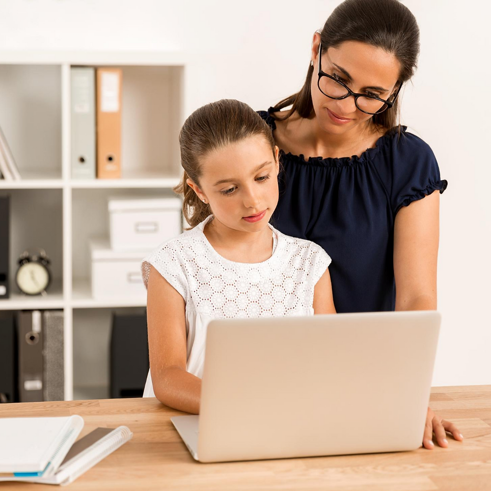 mother and daughter virtual learning during coronavirus