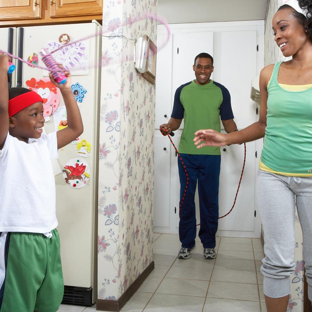 family exercising together indoors during coronavirus