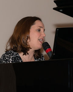 Music Therapist playing piano & singing