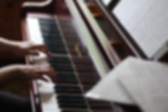 Music therapist playing piano