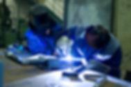 Welder master with trainee at work.jpg
