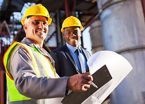senior oil industry worker holding clipb