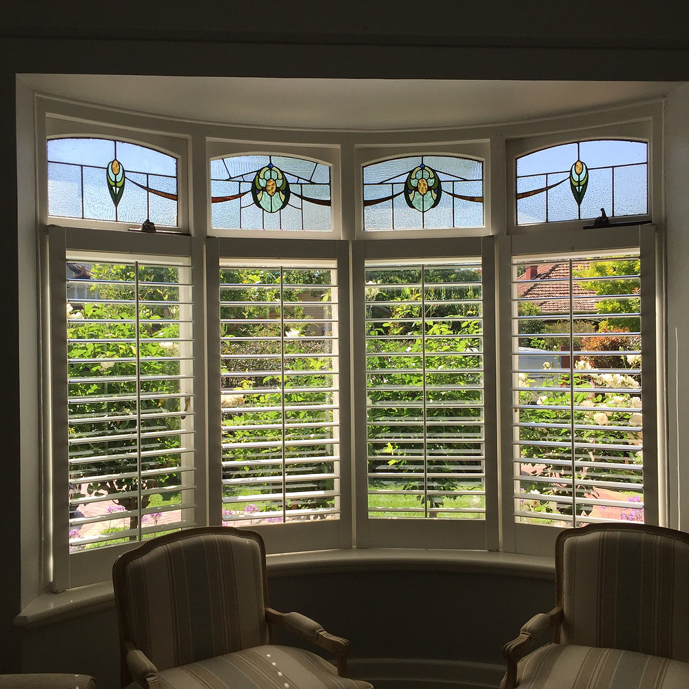 Lead light windows with plantation shutters