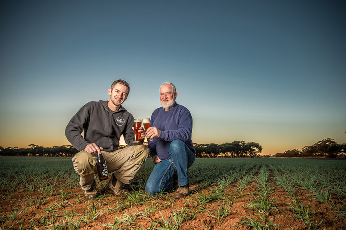 Schooner Barley Ken Whytcross (right) sells a portion of his Schooner barley grown on his farm near Barellan in southern New South Wales to his son Stuart, who turns it into malt for the booming craft brewing market. Photo by Nicole Baxter for the GRDC