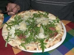 Pizza from a pizzeria next door