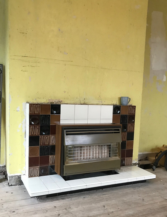 Original gas fire and tiled fireplace.