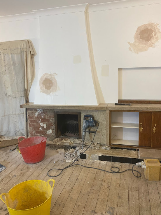 Starting to dismantle and take up the hearth.