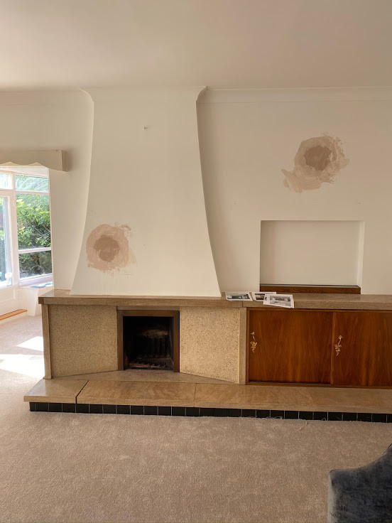 Original fireplace, canopy, extended hearth and built in cupboards.