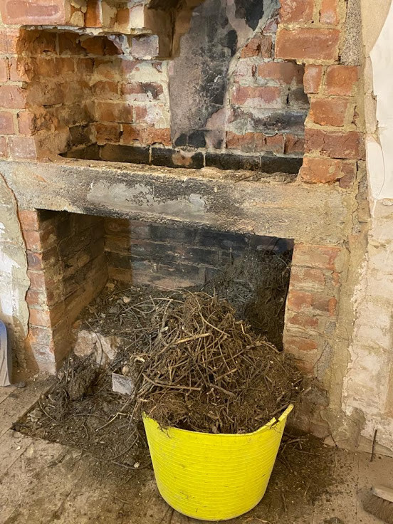 Removal of old birds nests and taking out bricks above the existing lintol so that we can make the opening bigger.