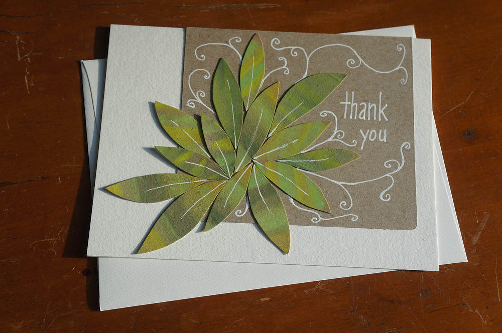 Fun is a Necessity Thank You card with green leaves and white flourishes and text.