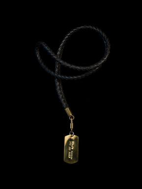 Italian leather and handmade brass dog tag.