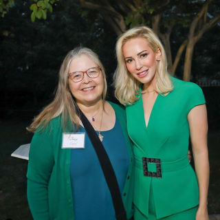 Louise pictured with Art Therapist and Program Director Tracy Councill of Tracy's Kids at a fundraiser hosted by Linton.  Louise has raised over $1,000,000 for Tracy's Kids.