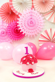 Bright pink 1st birthday giant cupcake
