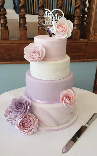 Lilac and White Wedding Cake With Sugar Roses