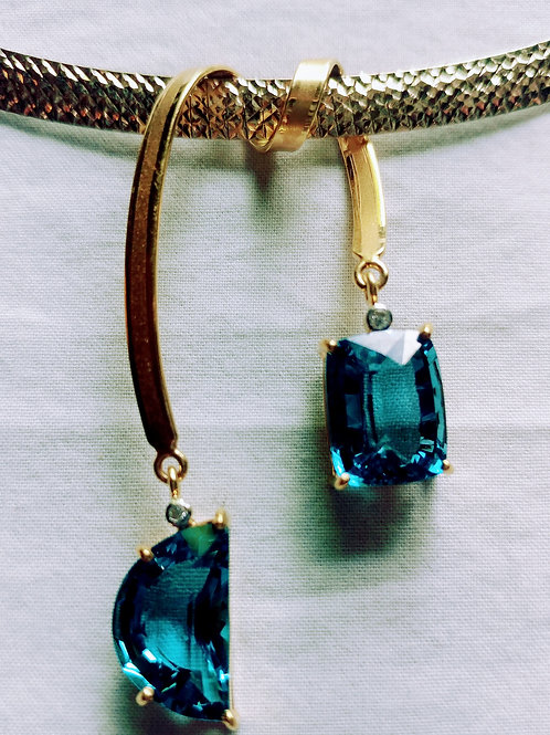 Beautiful blue topaz  22k. yellow gold & necklace