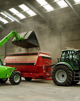Loading Grain into Mixer