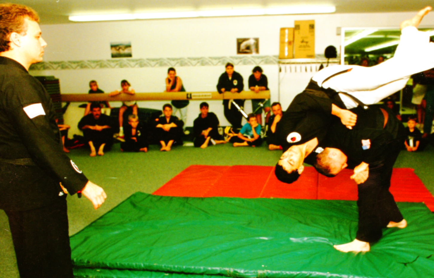 Performing a shoulder throw on Sensei Mo
