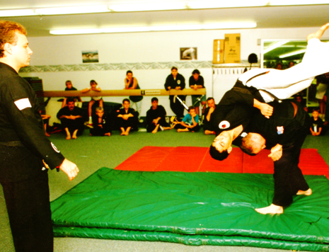 Performing a shoulder throw on Sensei Mo