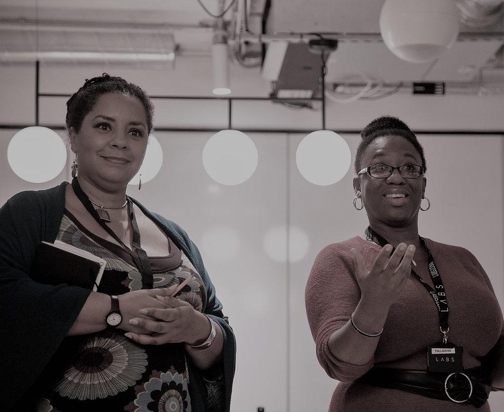 Sarah Quist and Ann-marie Idiagbonya CEO's of Creative Awakenings running a course.jpg