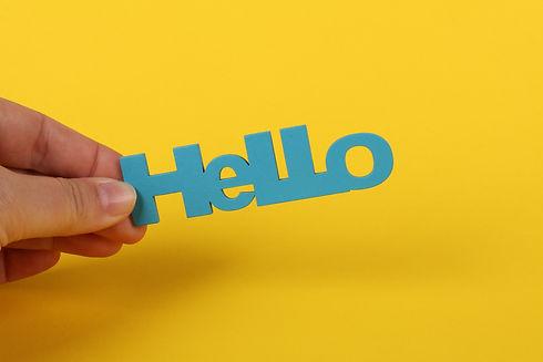 Hand holding the word hello in blue pexels-ann-h-4476842.jpg.jpg