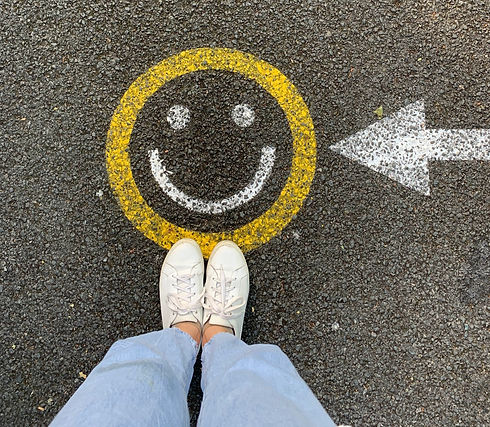 Drawn face with a smile and a persons feet image by Jacqueline Munguia.jpg