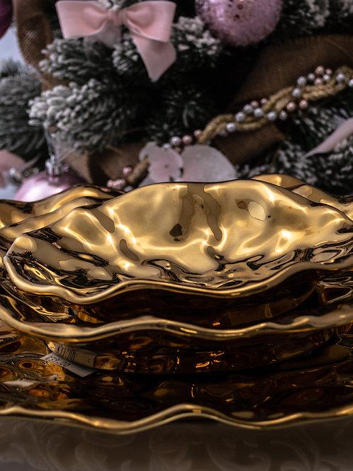 Tris piatti da portata dorati