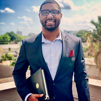 Rayven J. Moore suit handsome black man glasses